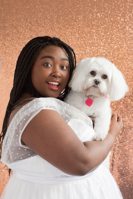 Adorable senior portrait of teenager with pet dog. African American beauty, senior portrait, Fairbanks, Alaska.
